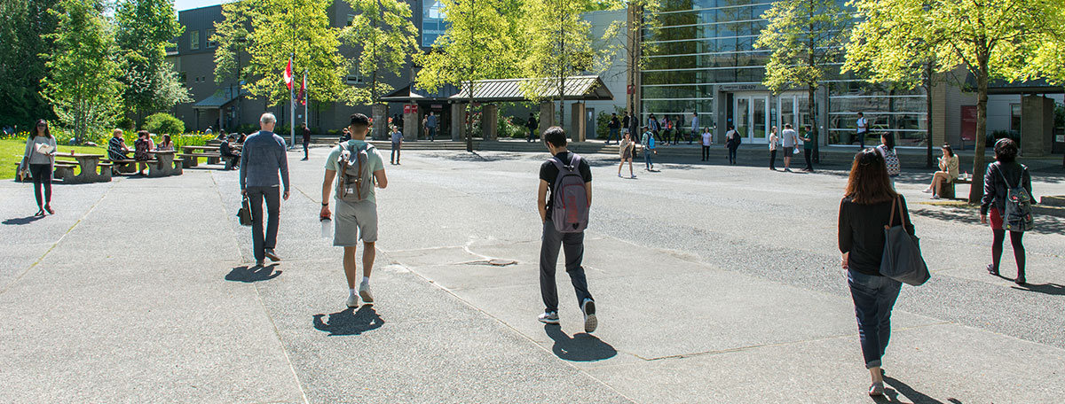 Students walking in Surrey Courtyard
